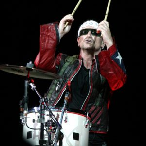 U2 frontman Bono plays the drums in San Jose during the 2005 tour.